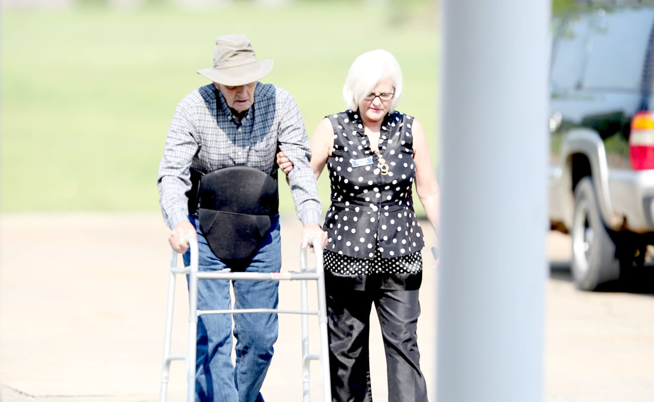 A resident walking with the help of a staff member at Providence Assisted Living in Batesville, Mississippi.