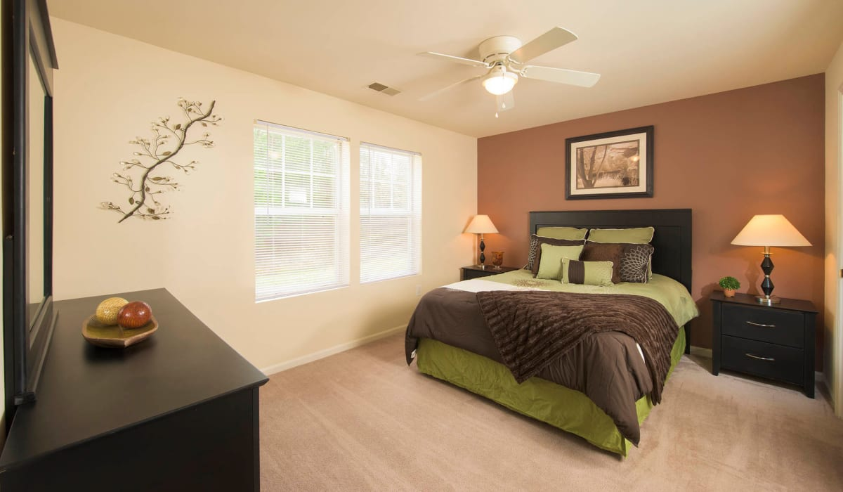 The main bedroom with plush carpeting and a ceiling fan at Park Villas Apartments in Lexington Park, Maryland