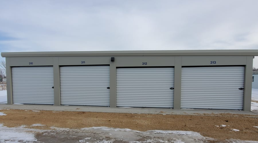 Exterior view of storage units with white doors at KO Storage of Albert Lea in Albert Lea, Minnesota