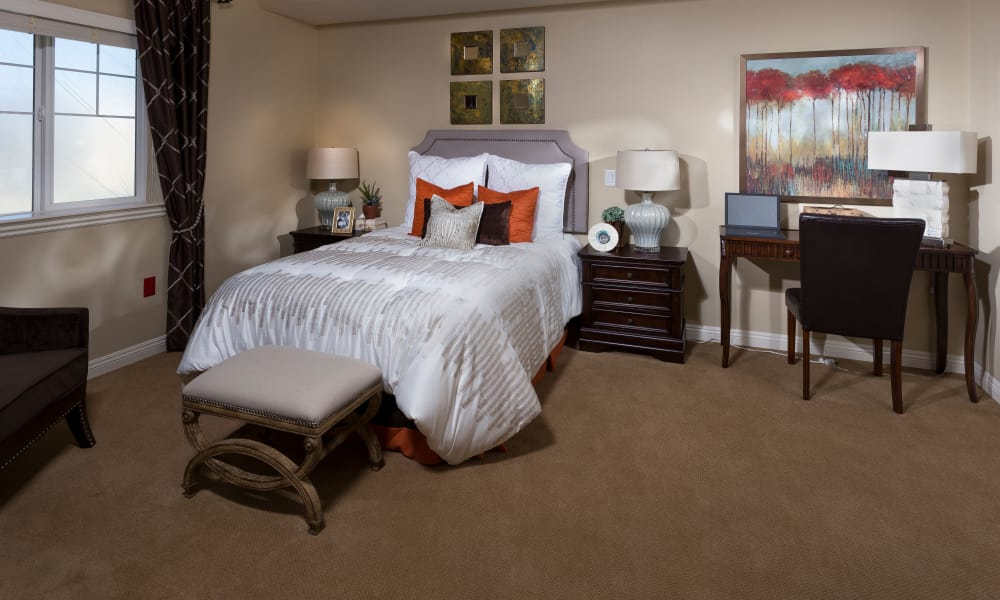Bedroom at senior living community in Corona, California