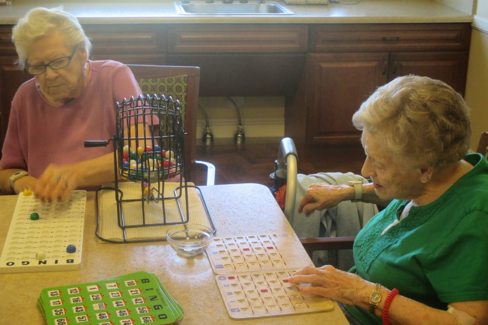 Resident playing bingo at Eastern Star Masonic Retirement Campus in Denver, CO