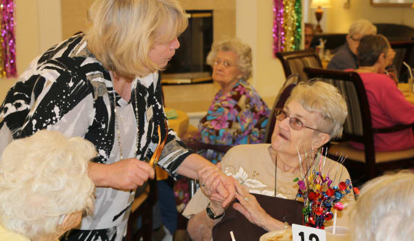 Staff member caring for our residents at Azalea Estates of New Iberia in New Iberia, LA.