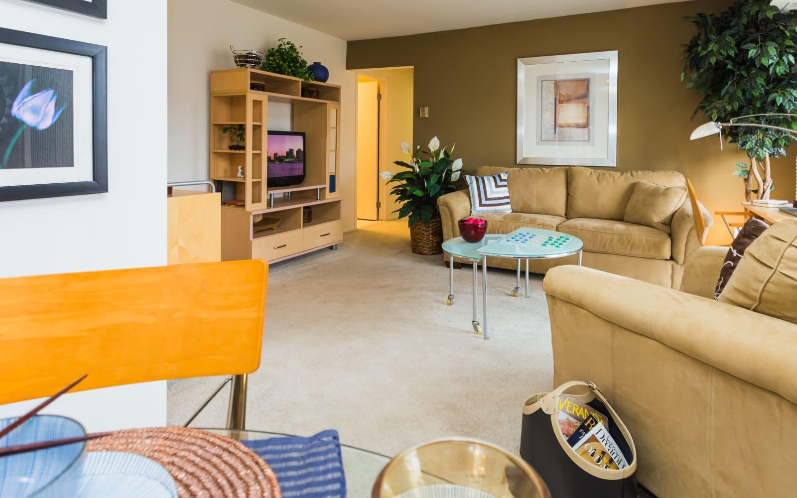 Living room area at Fairmont Park Apartments in Farmington Hills, Michigan