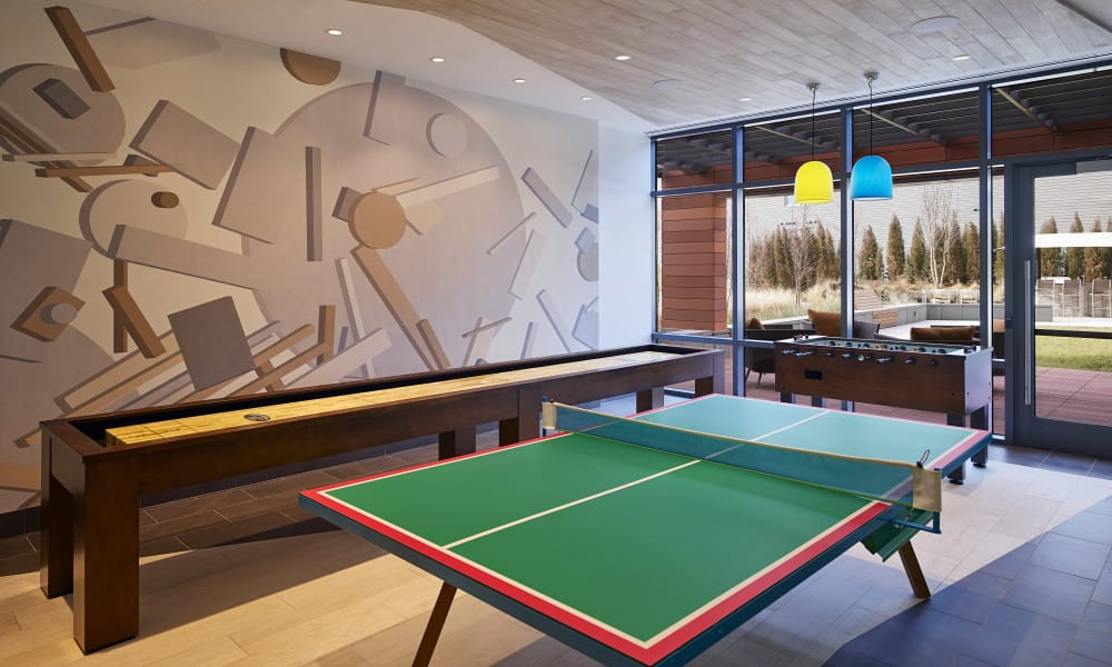 Game room with a ping-pong table at Solaire 8250 Georgia in Silver Spring, Maryland