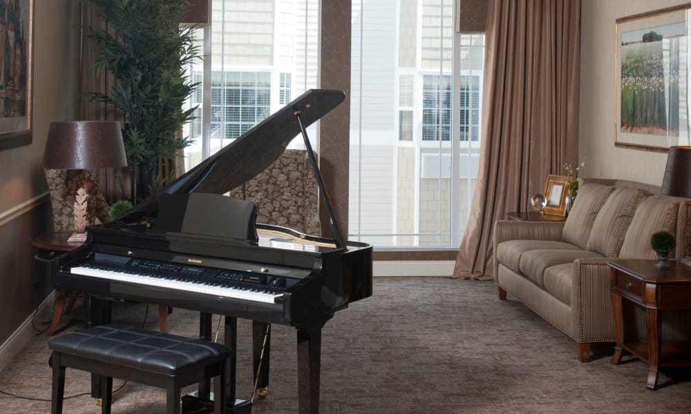 Music room with comfortable seating at The Neighborhoods by TigerPlace in Columbia, MO