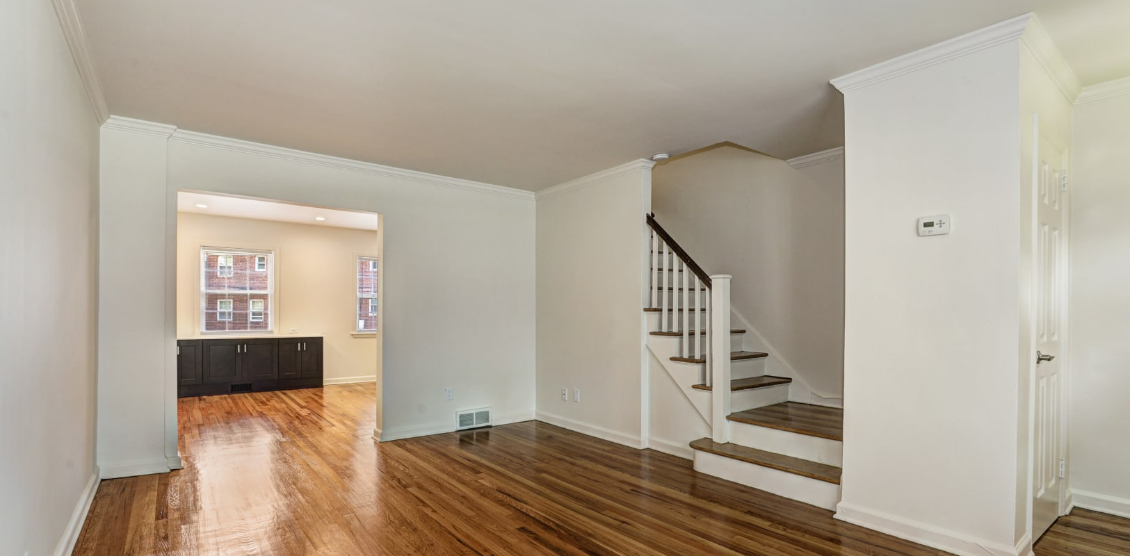 Spacious living room with upstairs access at General Wayne Townhomes and Ridgedale Gardens in Madison, New Jersey
