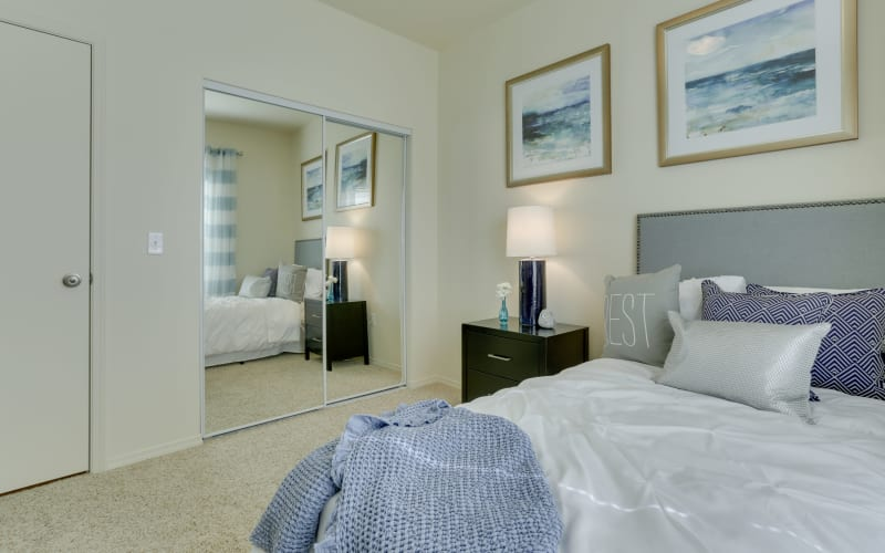 Spacious master bedroom with plush carpeting at The Landings at Morrison Apartments in Gresham, Oregon