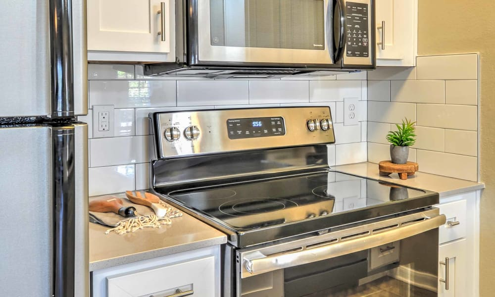 Enjoy upgraded stainless steel appliances in the kitchens at The Atlantic Station in Fort Worth, Texas