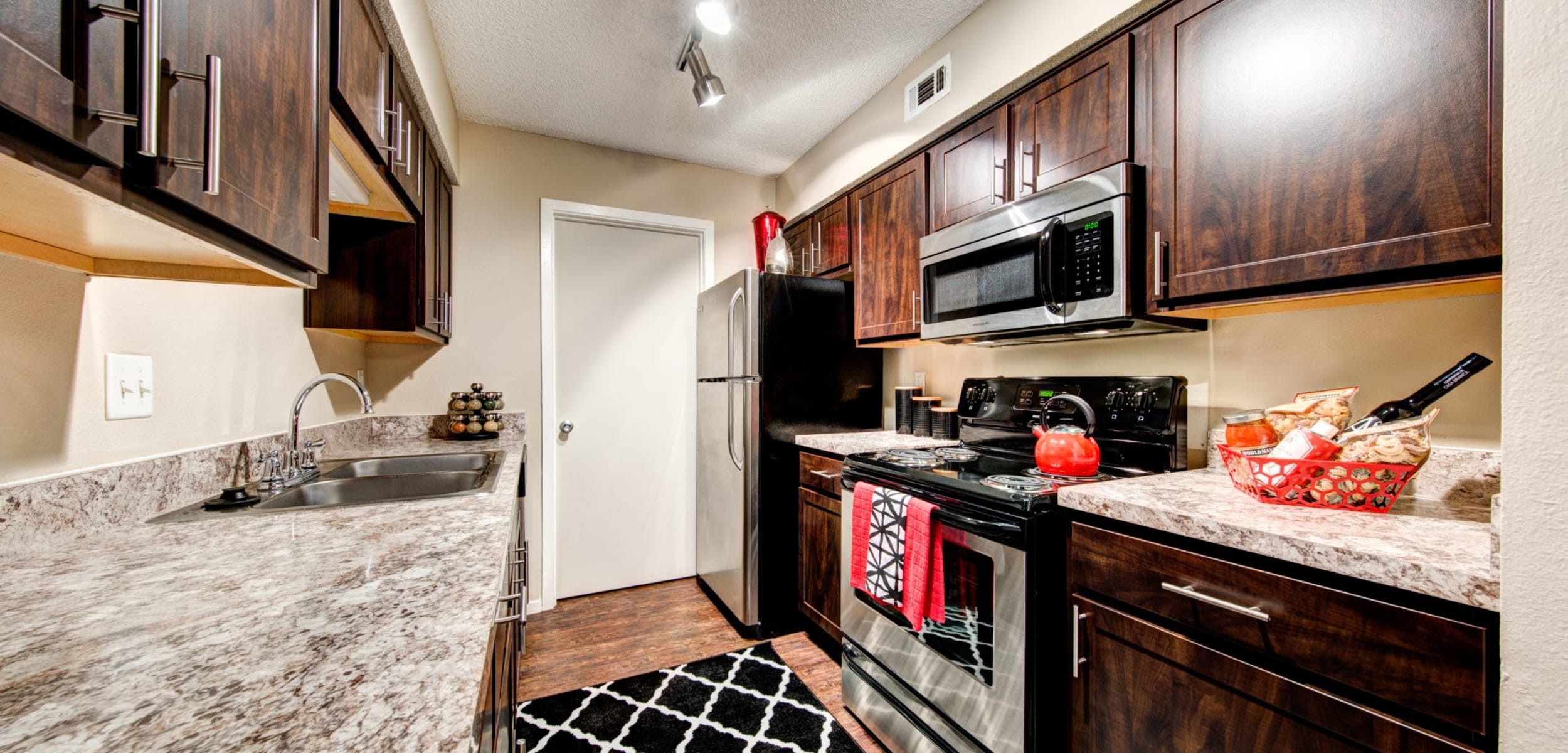 Modern kitchen with stainless steel appliances at The Park at Flower Mound in Flower Mound, Texas