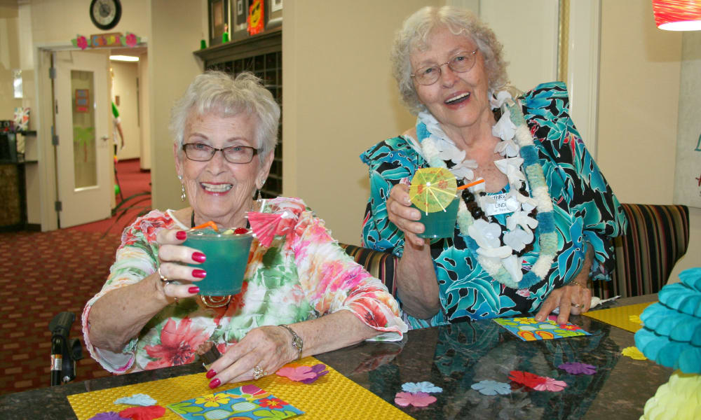 Two residents having drinks at Carolina Estates in Greensboro, North Carolina