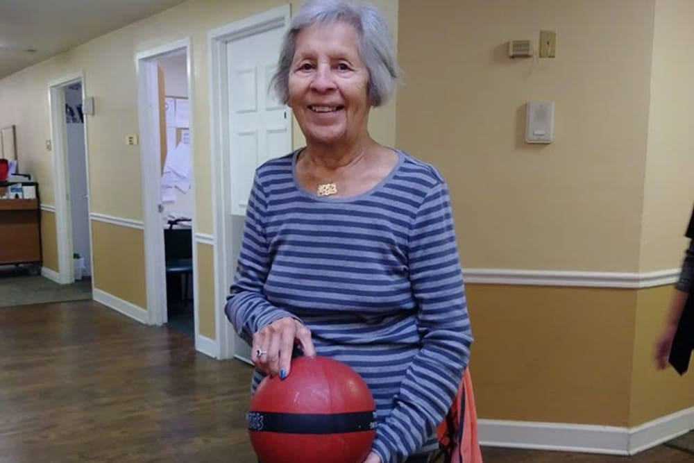 A resident holding a ball at Spring Oaks in Brooksville, Florida