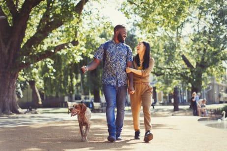 Couple walking their dog in a park near Berkshire Laurel Creek, Fairfield, California