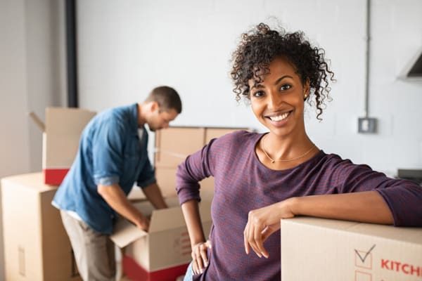 Man and woman packing boxes for climate controlled storage at Maximum Mini Storage Rittiman