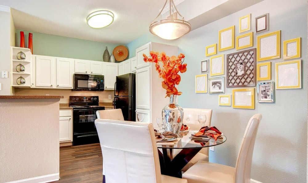 White cabinetry kitchen and dining area