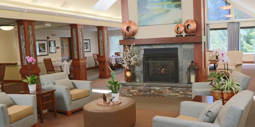 Comfortable lounge area with fire place at The Springs at Carman Oaks in Lake Oswego, Oregon