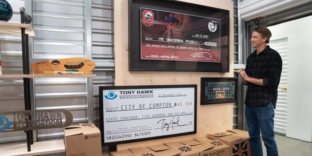 Oversized checks from the Tony Hawk Foundation