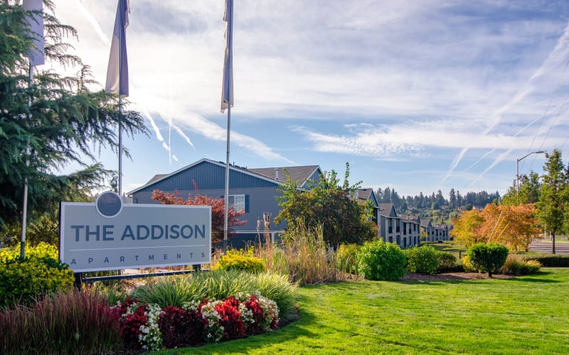 The front monument sign at The Addison Apartments in Vancouver, Washington