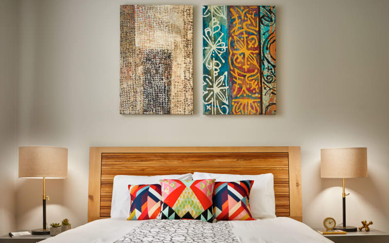 Spacious bedroom with paintings on the wall at Brookside Village in Auburn, Washington