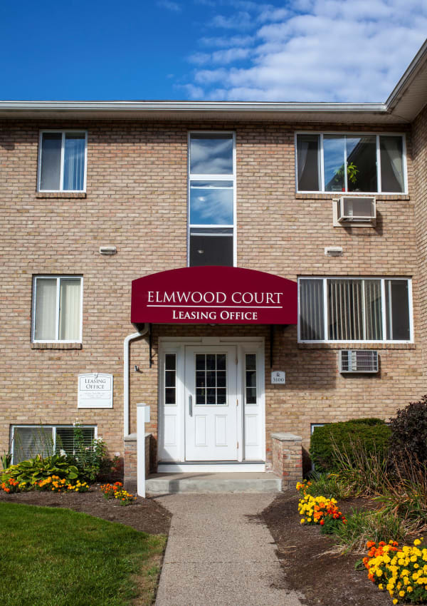 Exterior view of the rental office at Elmwood Court Apartments in Rochester