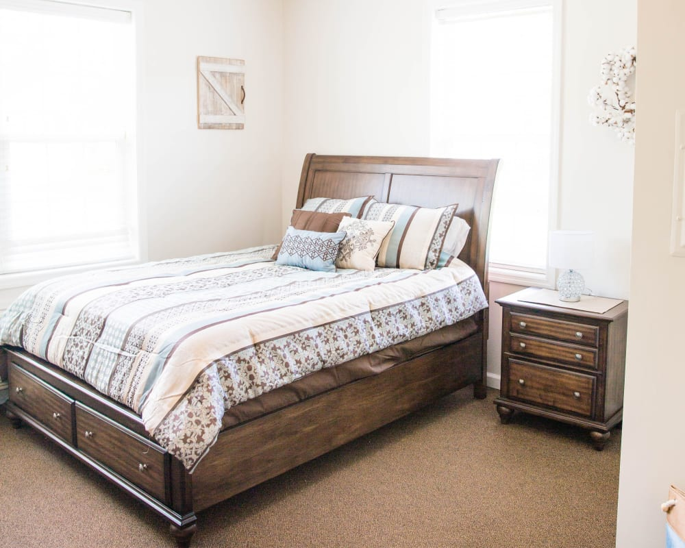 Cozy bedroom with large window at Arcadian Cove in Richmond, Kentucky.