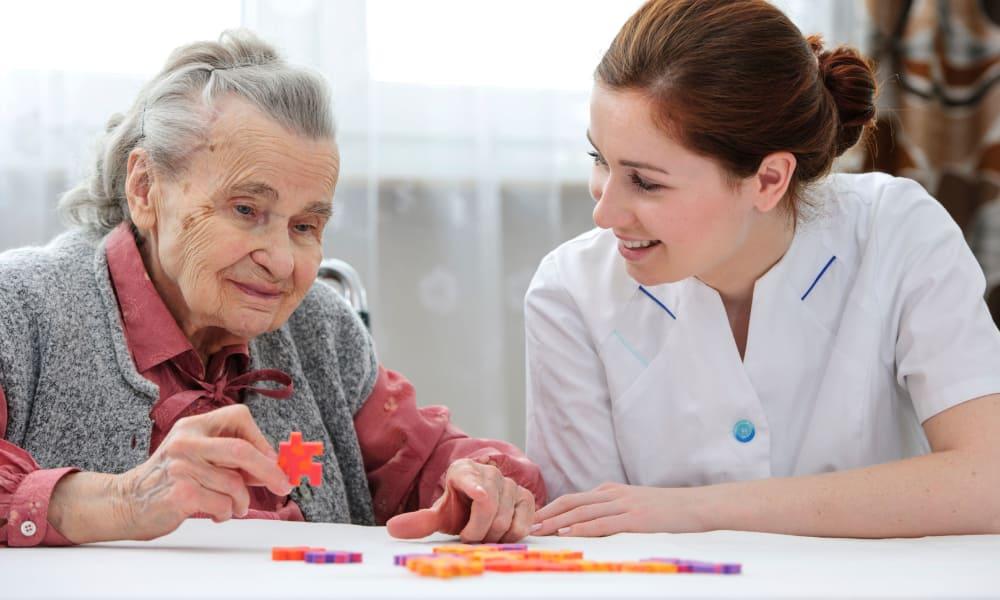 Senior woman doing a puzzle at The Phoenix at Estero in Estero, Florida