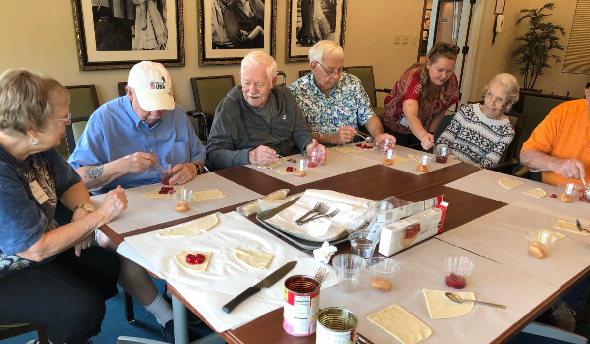 Residents making pastries together at a CERTUS Premier Memory Care Living community.