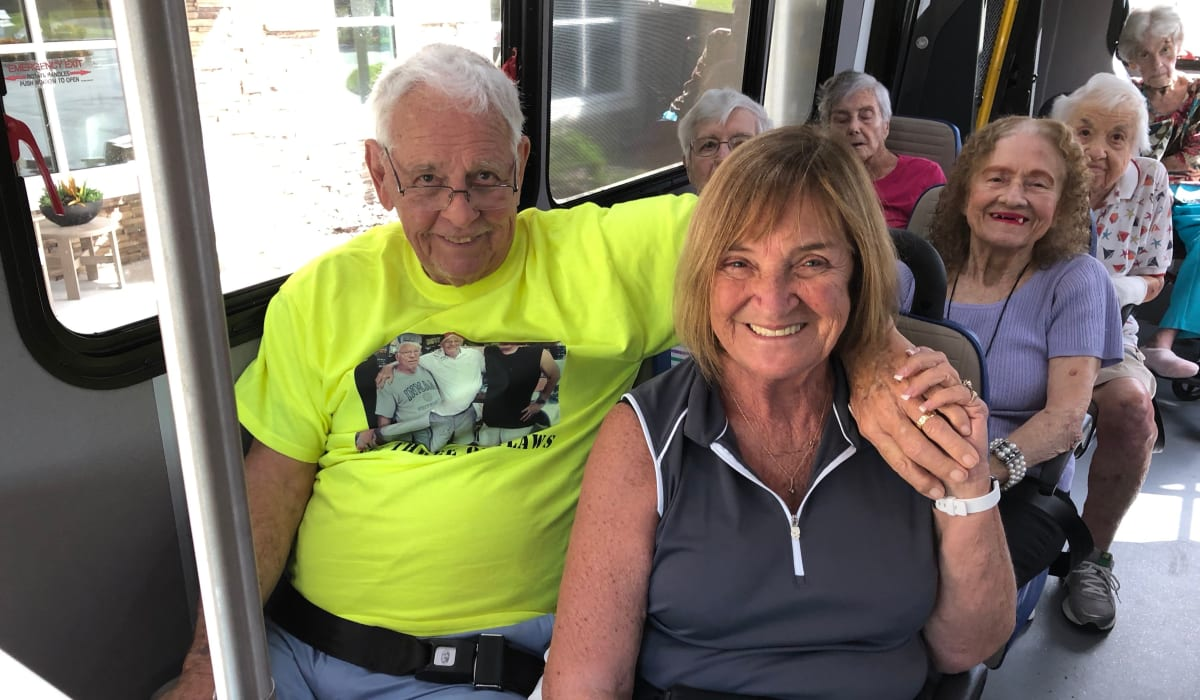 Two residents on the CERTUS Premier Memory Care Living transportation bus in Heathrow, Florida.