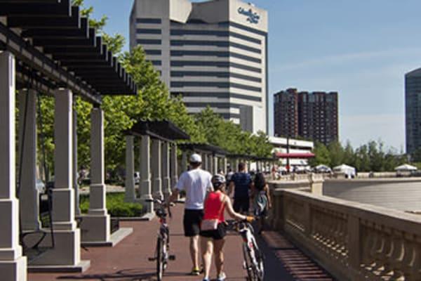 Couple walking their bikes through Cincinnati, Ohio near Lakeshore Drive