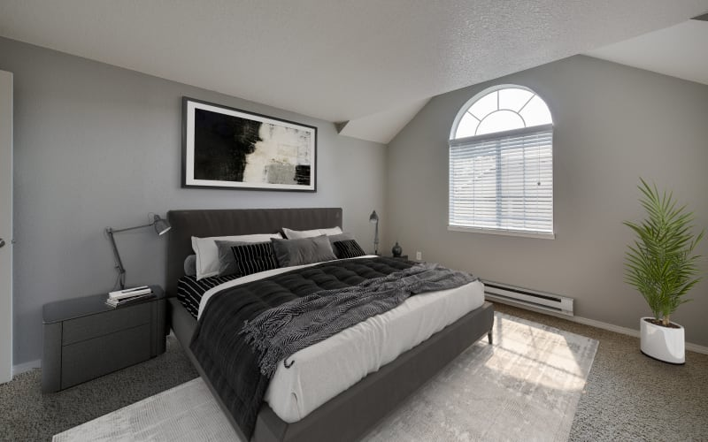 Spacious master bedroom with plush carpeting at Walnut Grove Landing Apartments in Vancouver, Washington