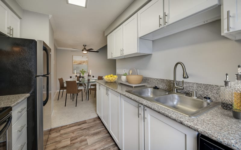 Renovated kitchen with white cabinets at Walnut Grove Landing Apartments in Vancouver, Washington