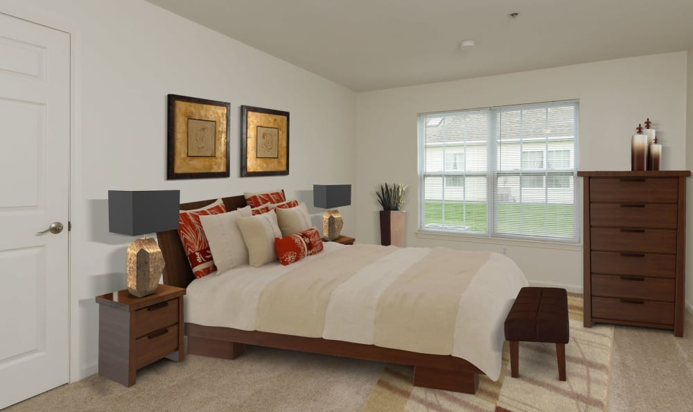 Well decorated bedroom at Villas of Victor and Regency Townhomes in Victor, NY
