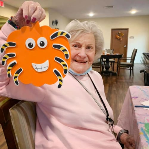 Resident holding a handmade halloween decoration at The Oxford Grand Assisted Living & Memory Care in McKinney, Texas