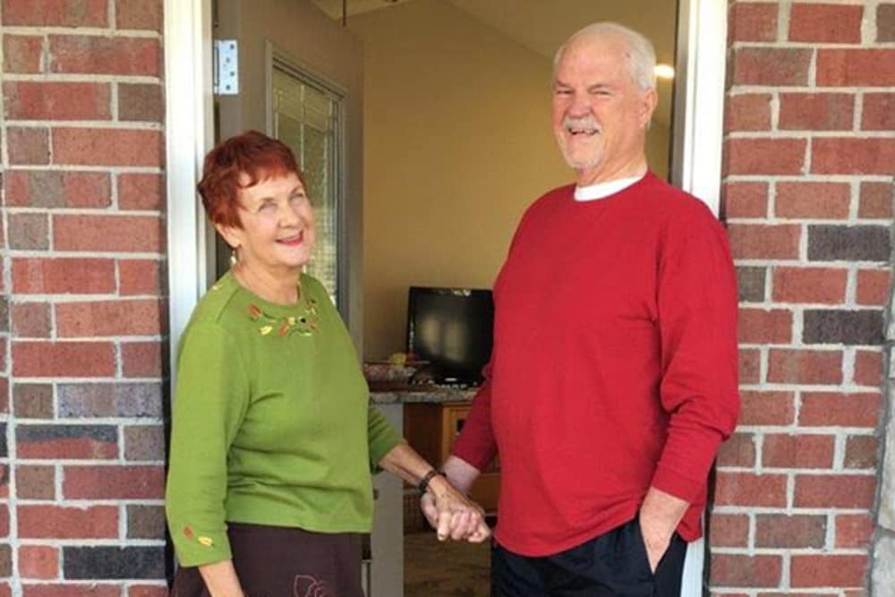 A couple posing in front of their villa at Harrison Springs Health Campus in Corydon, Indiana