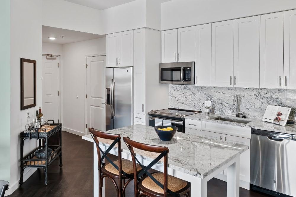 Model kitchen with adaptable island and quartz countertops at Town Lantana in Lantana, Florida