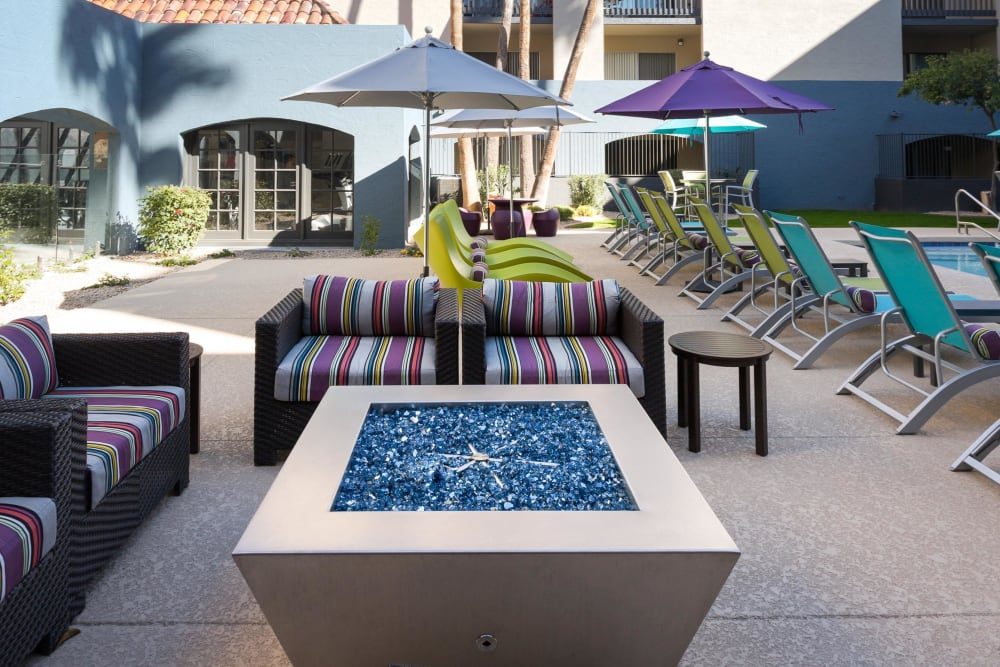Poolside patio with firepit at 4127 Arcadia in Phoenix, Arizona
