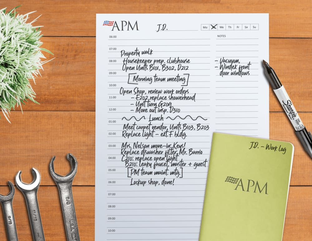 A view of a maintenance worker's day planner at a community managed by American Property Management in Bellevue, Washington