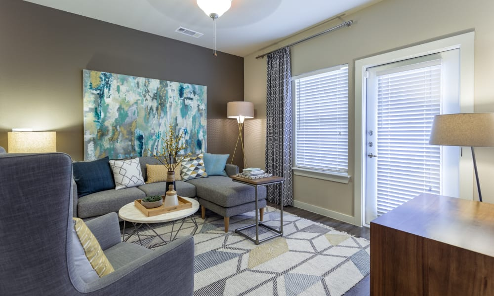 Naturally well-lit living room at Encore 281 in San Antonio, Texas