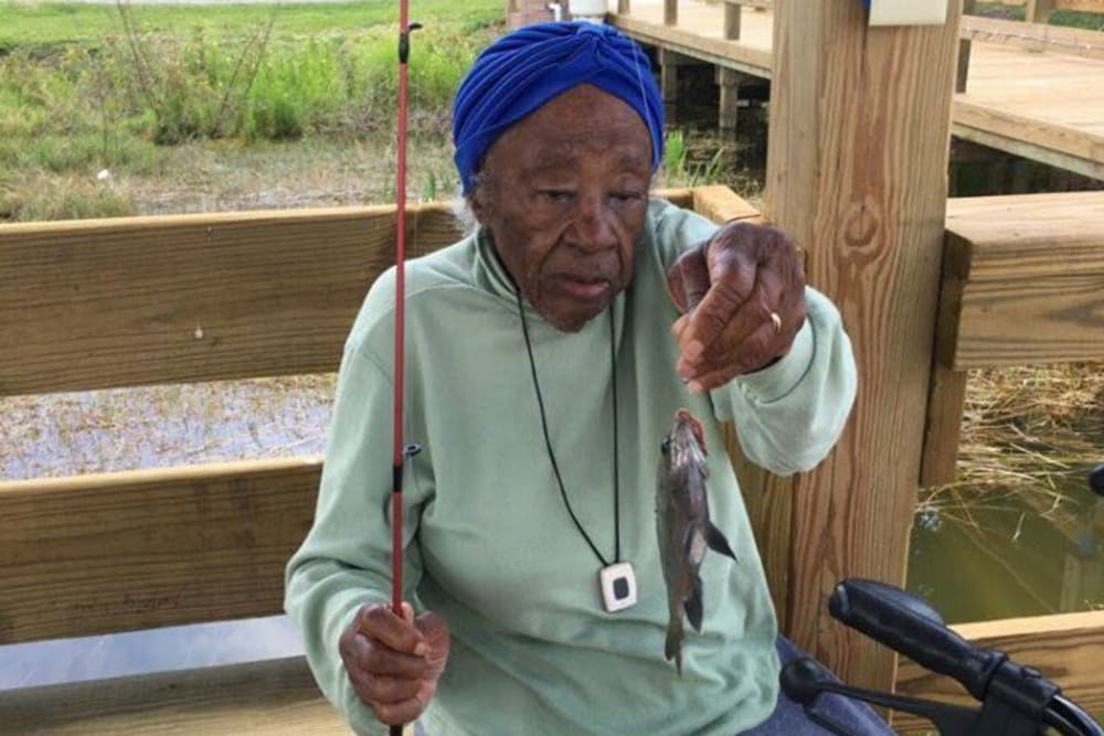 A resident with a fish at Spring Haven in Winter Haven, Florida