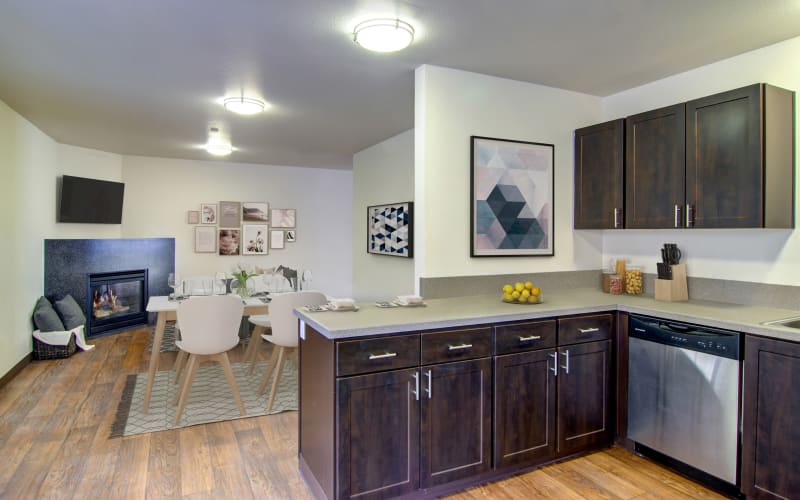 Spacious and bright kitchen and living room with a fireplace at The Addison Apartments in Vancouver, Washington