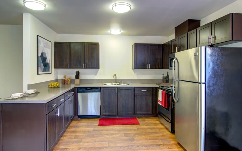 Espresso cabinets in a kitchen at The Addison Apartments in Vancouver, Washington
