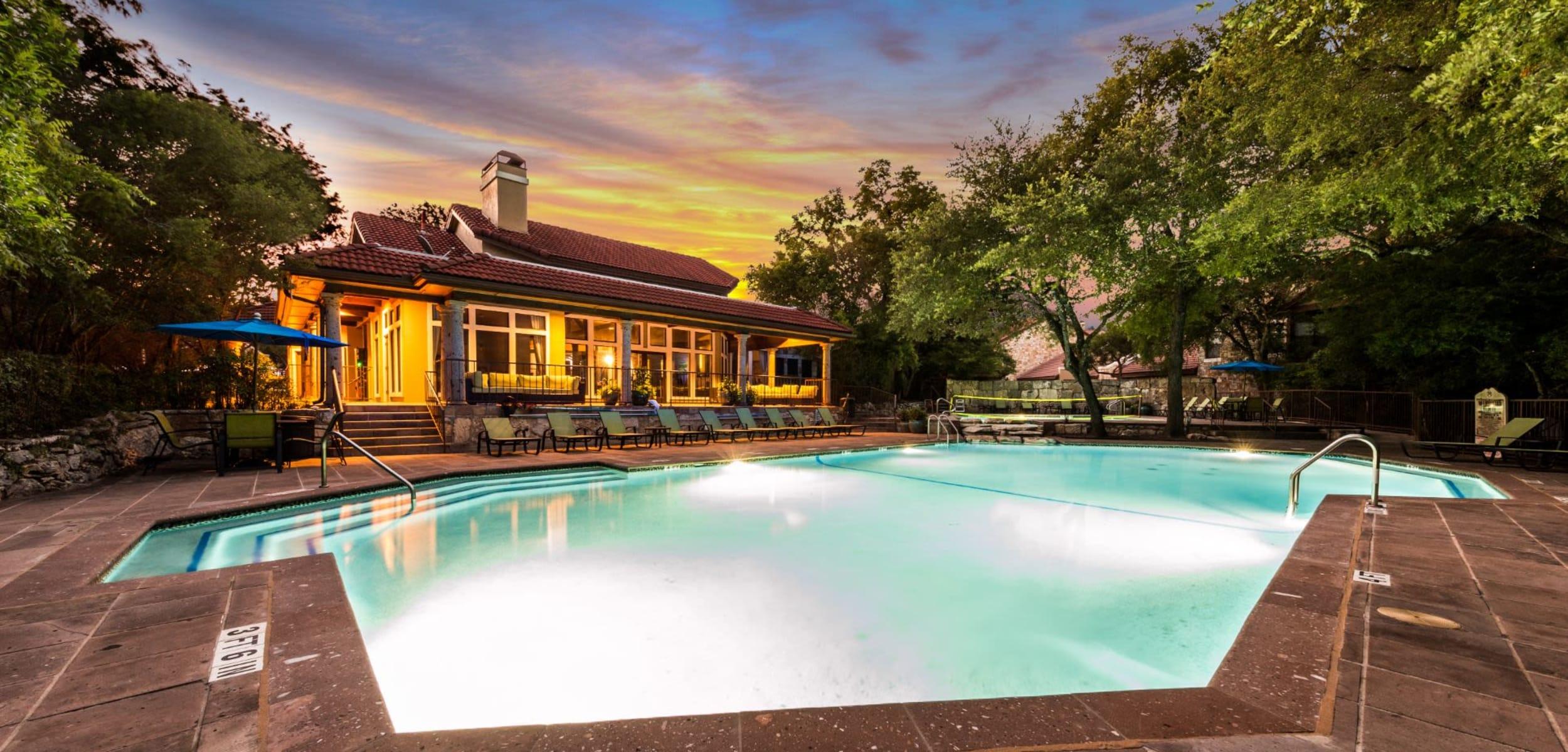 Sparkling swimming pool at dusk at Marquis at Caprock Canyon in Austin Texas,
