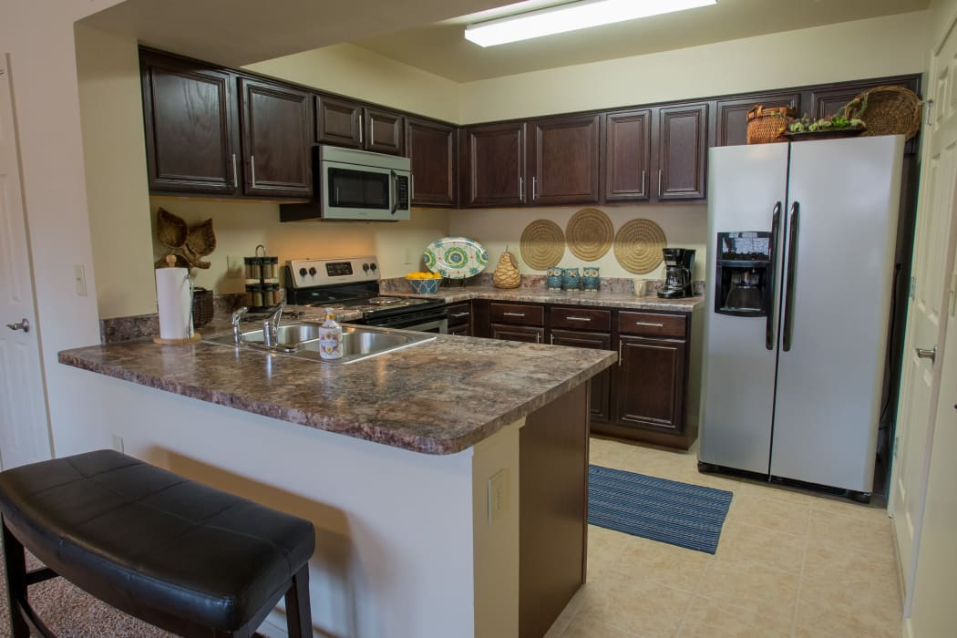 Well equipped kitchen at Park at Tuscany in Oklahoma City, Oklahoma