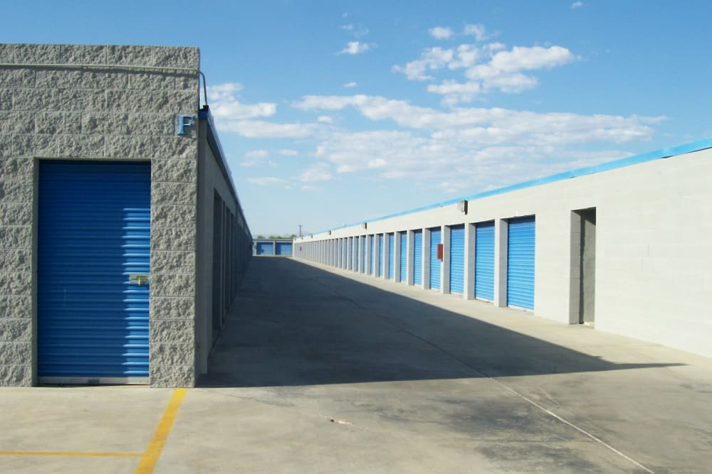 Outdoor drive-up access storage units at A-American Self Storage in Ridgecrest, California