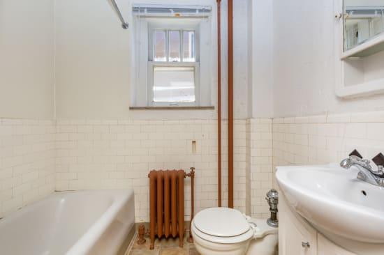 Bright bathroom at Concord & Castle in Des Moines, Iowa