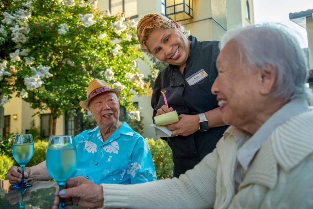Two residents ordering food on the outdoor patio at Merrill Gardens at Lafayette in Lafayette, California.