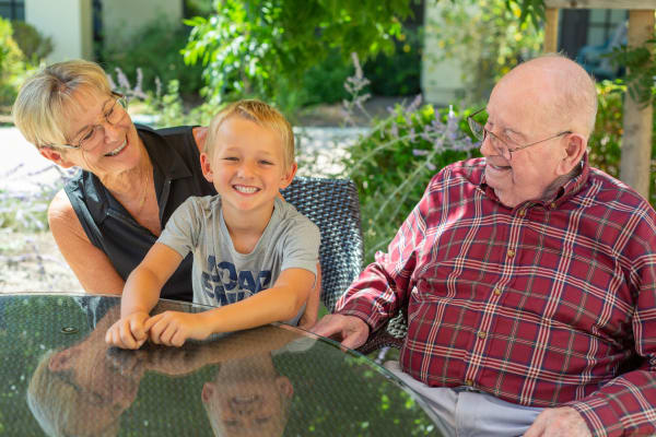 Grandparents with grandson at Merrill Gardens at Anthem