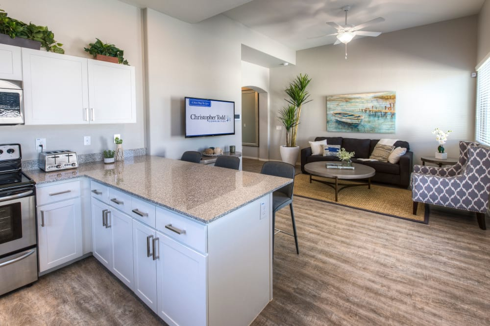 Beautiful open-concept floor plan with wood-style floors at Christopher Todd Communities At Stadium in Glendale, Arizona