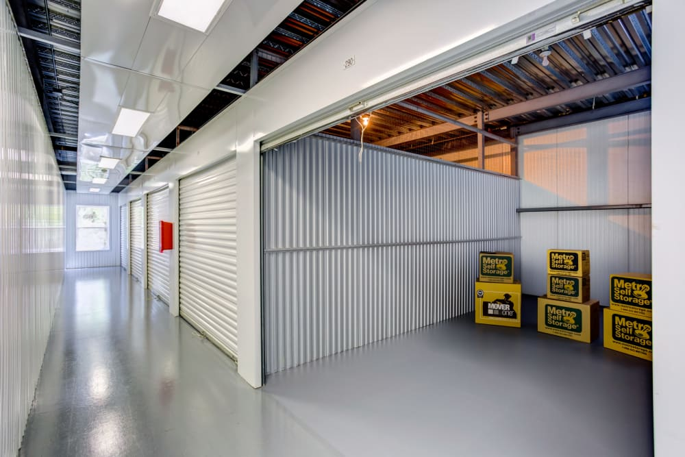 Open indoor unit with packages at Metro Self Storage in Tampa, Florida