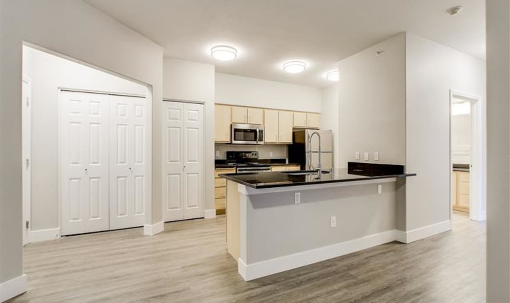 Corner view of a kitchen in a model home at River Trail Apartments in Puyallup, Washington
