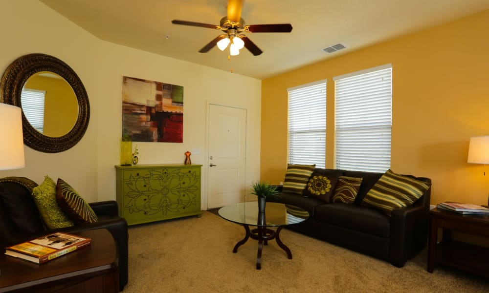 Ceiling fan and plush carpeting in the living area of a model apartment at The Hawthorne in Jacksonville, Florida
